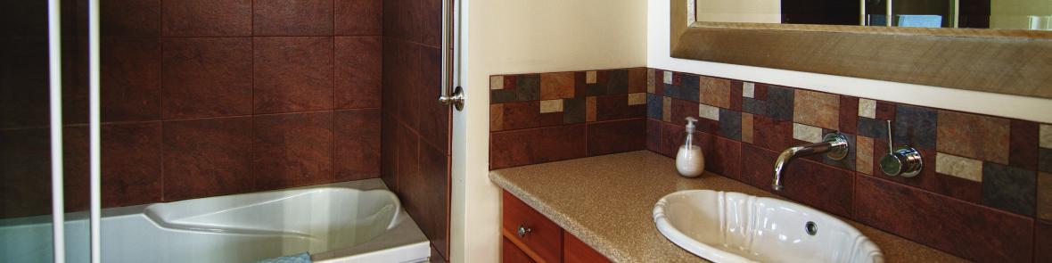 Ensuite bathroom with oversize soaker tub, rain shower, heated tiles