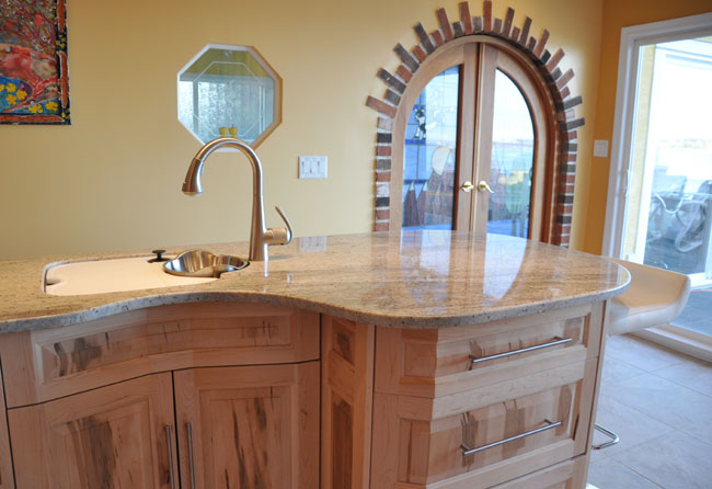 kitchen island with Frankie prep sink and custom granite counter top