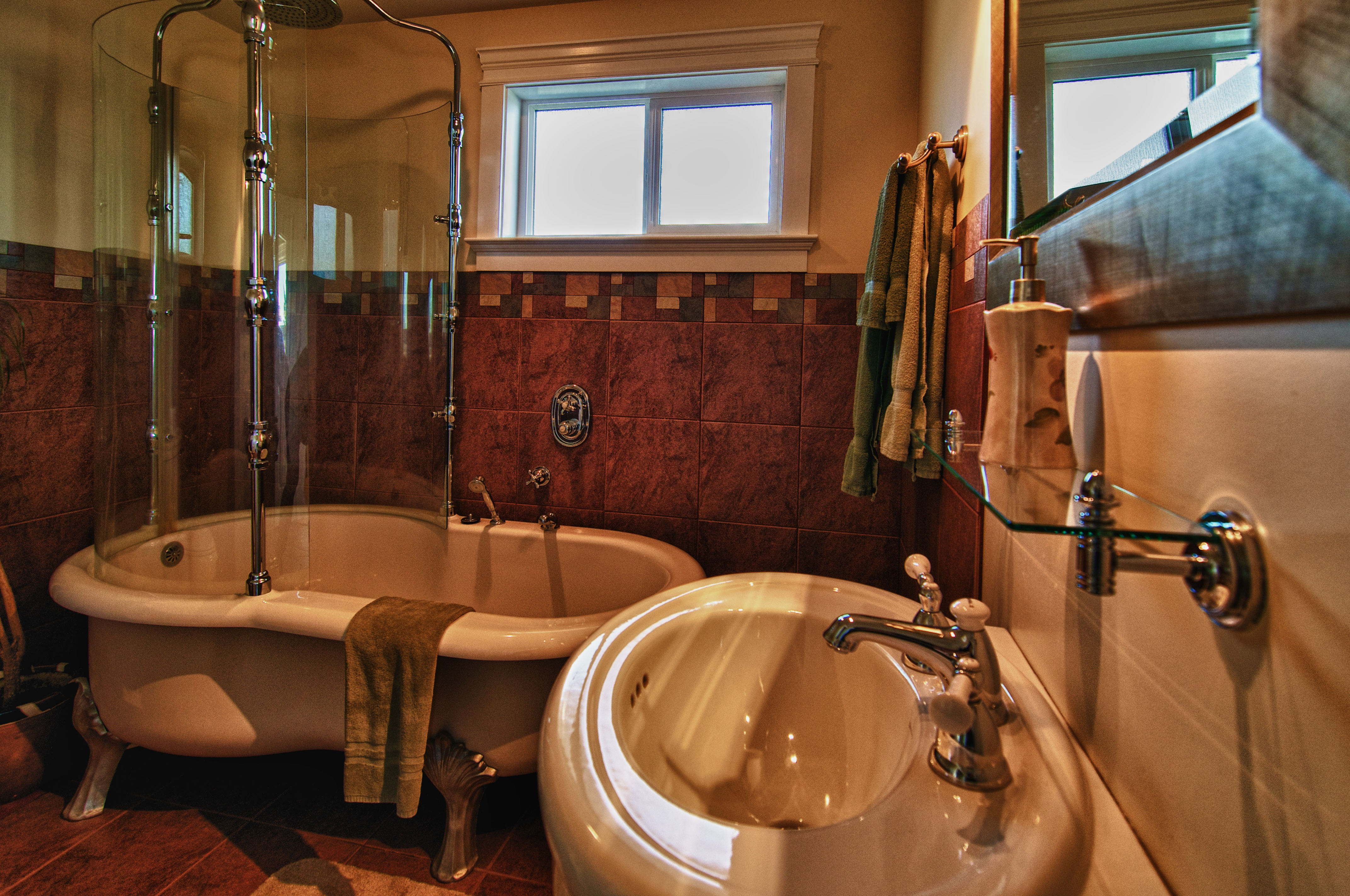 Honeymoon suite soaker tub and rain shower at Birds of a Feather B&B